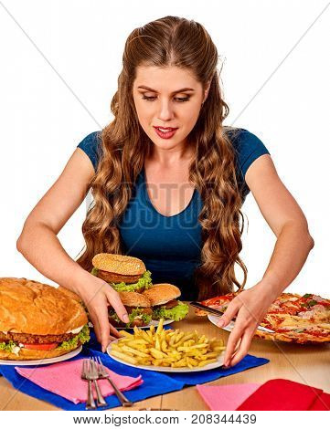 Woman eating french fries and hamburger. Student consume fast food on table. Girl drinks cola and dreams. Girl trying to eat junk. Advertise fast food on isolated.