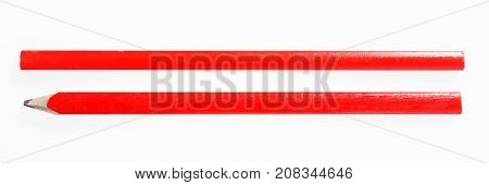 Two red construction pencils isolated on white background