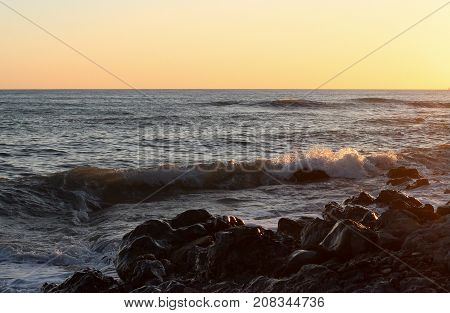 sea wave, sea and stones, sea coast, seashore, sunset on the sea