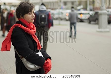 A Young Melancholy Woman Is Walking In The Street. Concept Of Loneliness. Copy Space