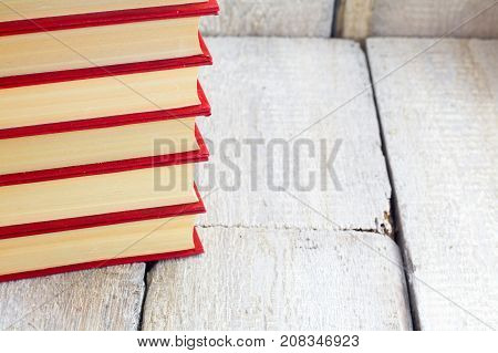 Old books on a wooden shelf. .