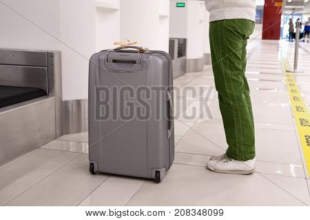 Passenger and baggage in check-in counter at airport