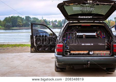 Saint-Petersburg Russia - September 30 2017: Pumped car VW Volkswagen Passat with music equipment amplifiers and speakers. Exhibition of car tuning music. Big Obukhovsky cable-stayed bridge