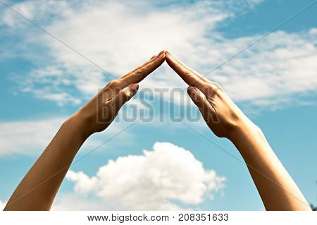 The Combined Hands, Are Forming A Triangle