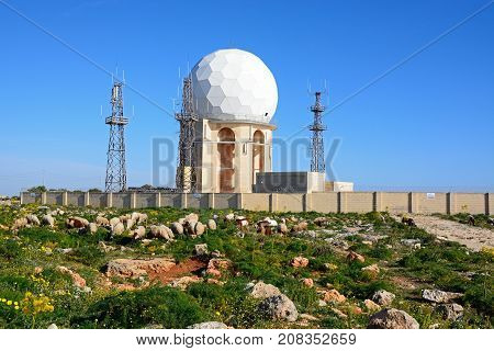 DINGLI, MALTA - APRIL 1, 2017 - View of Dingli Aviation radar station with sheep and goats in the foreground Dingli Malta, Europe, April 1, 2017.