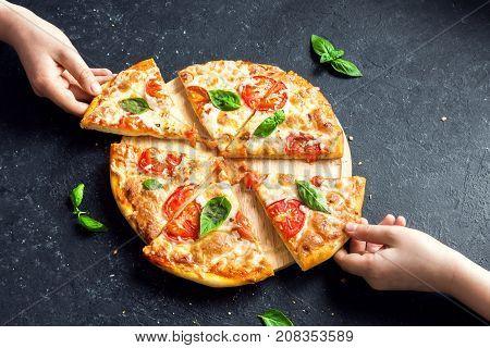 Taking Slice Of Pizza Margherita