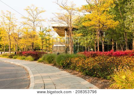 modern hotel conference convention center in secluded hidden location in nature with trees flowers in fall colors