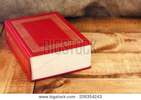 Old book on a wooden table. .