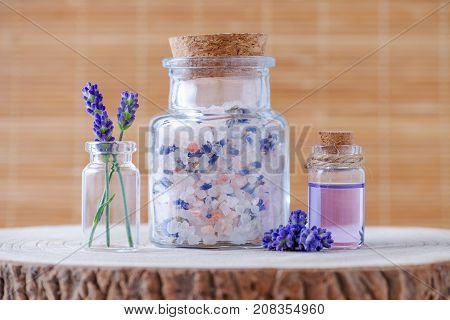lavender salt and essential oil with fresh lavender flowers