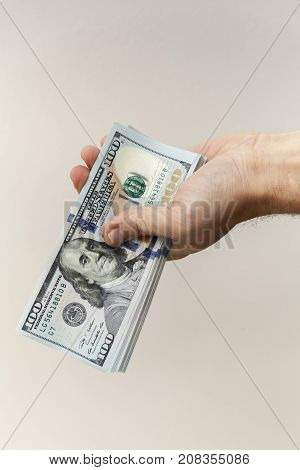 One Hundred Dollars Banknotes In Male Hand