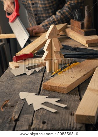Handyman or joiner working on wood making a Christmas tree creativity or ideas concept