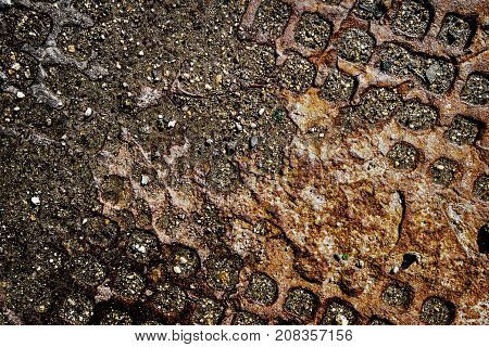 The old rusty manhole cover. Rusty metal texture background