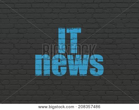 News concept: Painted blue text IT News on Black Brick wall background