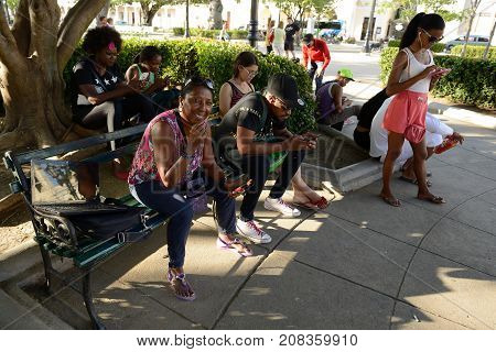 CIENFUEGOS CUBA - 06 NOVEMBER 2016: Cubans using the available Internet on the main square in cities on Cuba