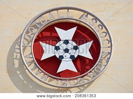 ATTARD, MALTA - APRIL 1, 2017 - Malta football association emblem on the front of the Centenary Stadium Attard Malta Europe, April 1, 2017.