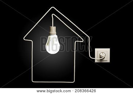 Glowing LED lamp in a house on black background