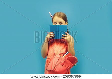 Pupil With Braids, Isolated On Blue Background. Back To School