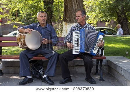 YEREVAN,ARMENIA - SEPTEMBER 24,2017:In the center of Yerevan street unknowns musicians playing a accordion and drum.