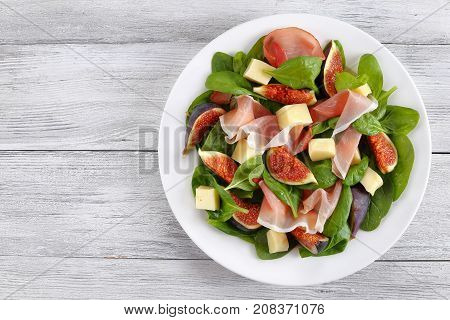 Salad Of Spinach, Figs, Prosciutto, Cheese