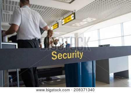 Man scanning luggage at airport security checkpoint