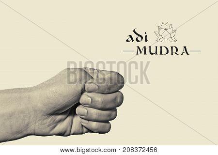 Adi mudra. Yogic hand gesture. Isolated on toned background black and white.