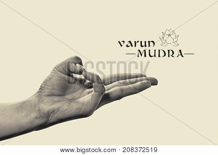Varun mudra. Yogic hand gesture. Isolated on toned background black and white.