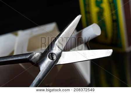 Quit smoking concept scissors cigarette and matches