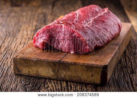 Beef Steak. Raw Beef Steak. Big Rib Eye Steak On Wooden Board