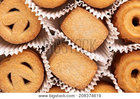 An overhead photo of Danish butter cookies in their paper skirts, a closeup of the traditional Christmas pastry