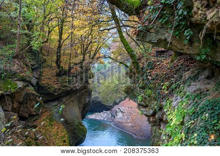 Beautiful autumn landscape with secluded mountain river and forest