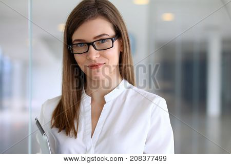 Portrait of modern business woman in the office.
