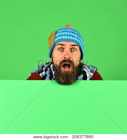 Man In Warm Hat On Green Background, Copy Space