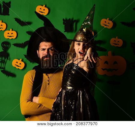 Girl And Bearded Man With Proud Faces On Green Background