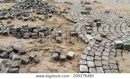 Reconstruction of a paved road in an old town.