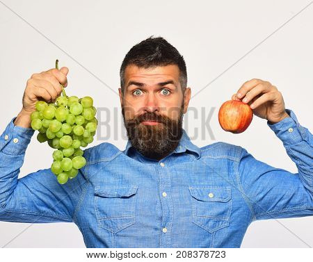 Man With Beard Holds Bunch Of Green Grapes And Apple