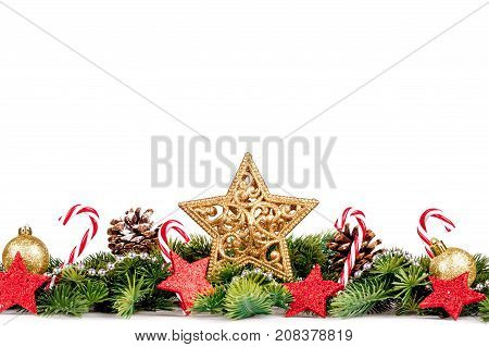 Christmas Border - tree branches with golden balls, candy and big star isolated on white, horizontal banner