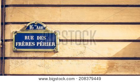 Blue Parisian Street Sign On A Stone Wall