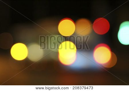Abstract defocused background with red-orange spots of light