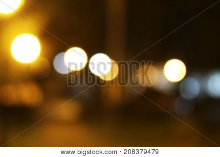 unfocused warm evening autumn background with spots of light