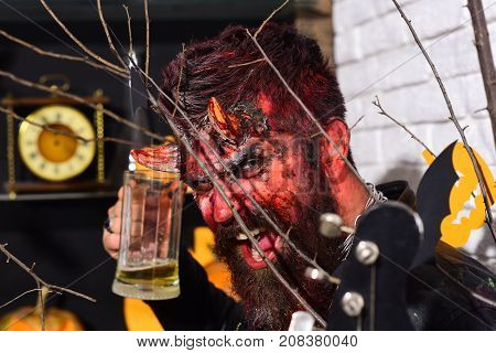 Man Wearing Scary Makeup Holds Mug Of Beer On Halloween