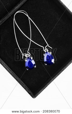 Blue sapphire silver earrings in black jewel box