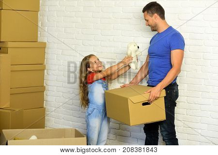 New Home And Family Concept. Kid And Guy Move In