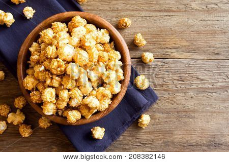 Homemade caramel popcorn in wooden bowl. Caramel popcorn