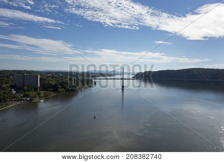 The Mid-Hudson Bridge spans across the Hudson River from Poughkeepsie to Highland New York.