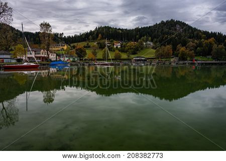 mirroring lake in the morning with boats