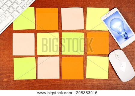 idea concept and twelve colorful adhesive notes on desk