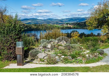 monastery herb garden in autumn with a lake