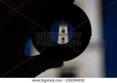 clock tower of a church seen through a lens