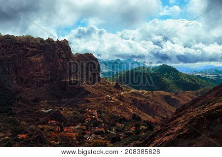 A Beautiful Wild Mountain Scape And Curves Winding Road High View In Green Mountains In Gran Canaria