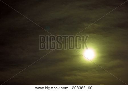 bright Moon in the black sky. mystical light from the Moon in a black sky. full moon